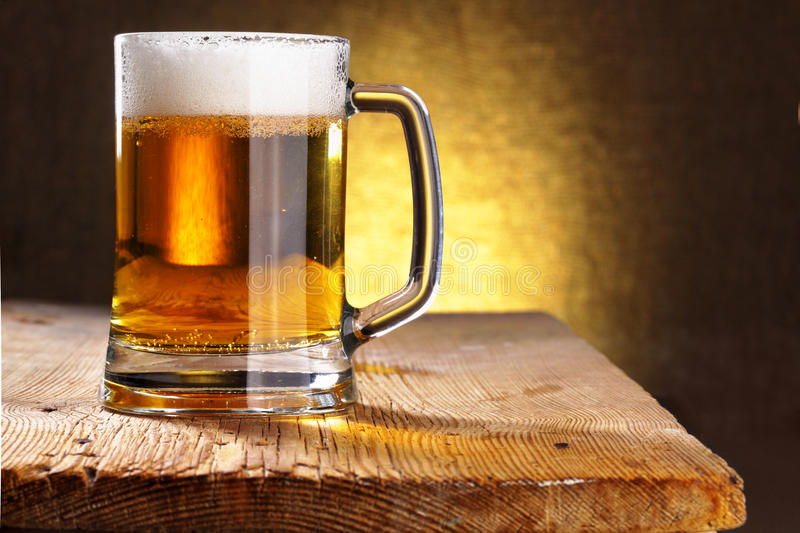Beer mug. Close-up on the wood table royalty free stock photo