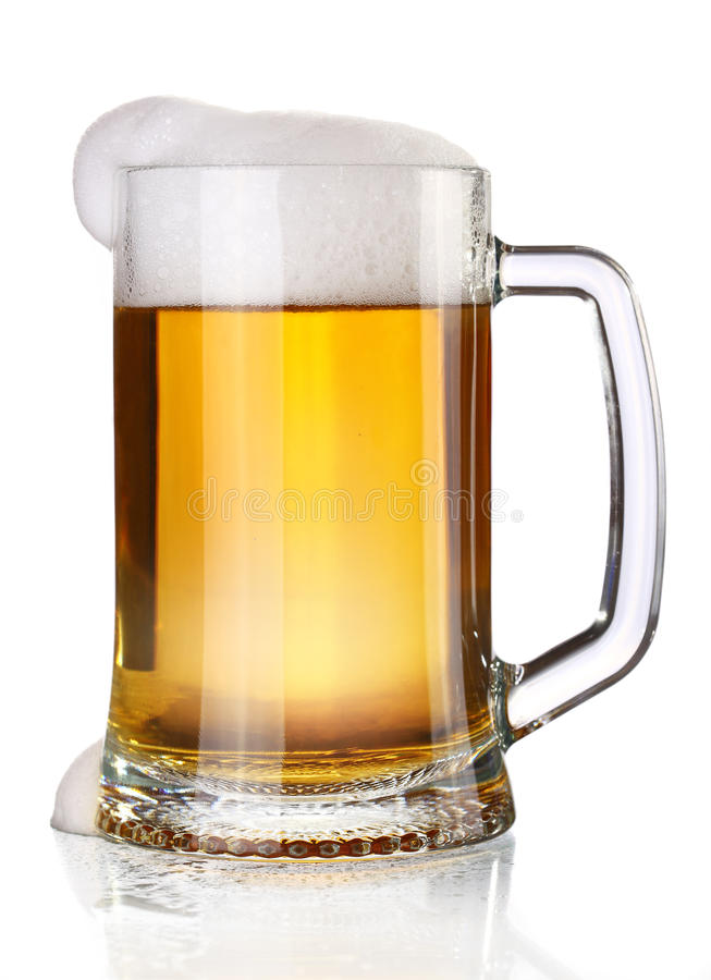 Beer mug. A large glass beer mug on a white background royalty free stock photos