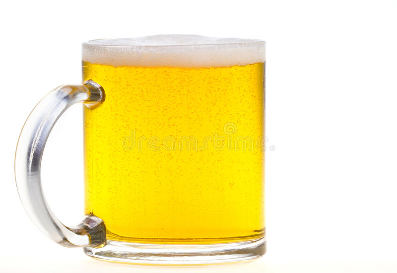 Beer mug. Close up of beer mug with bubbles and foam stock image
