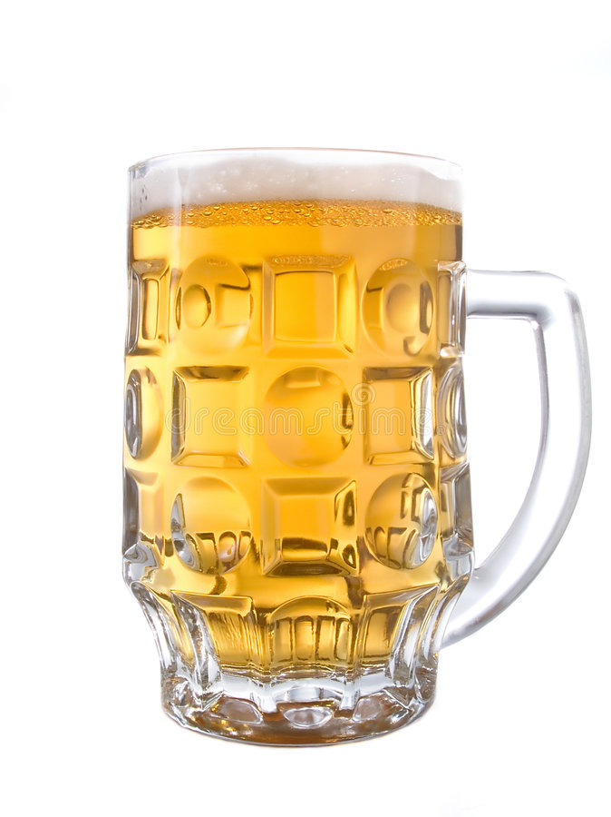 Beer mug. A glass beer mug filled with beer on white background royalty free stock image