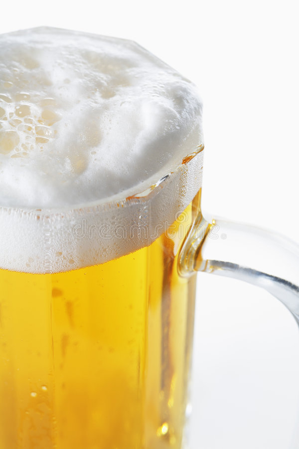 Beer mug. In closeup with lager beer royalty free stock image