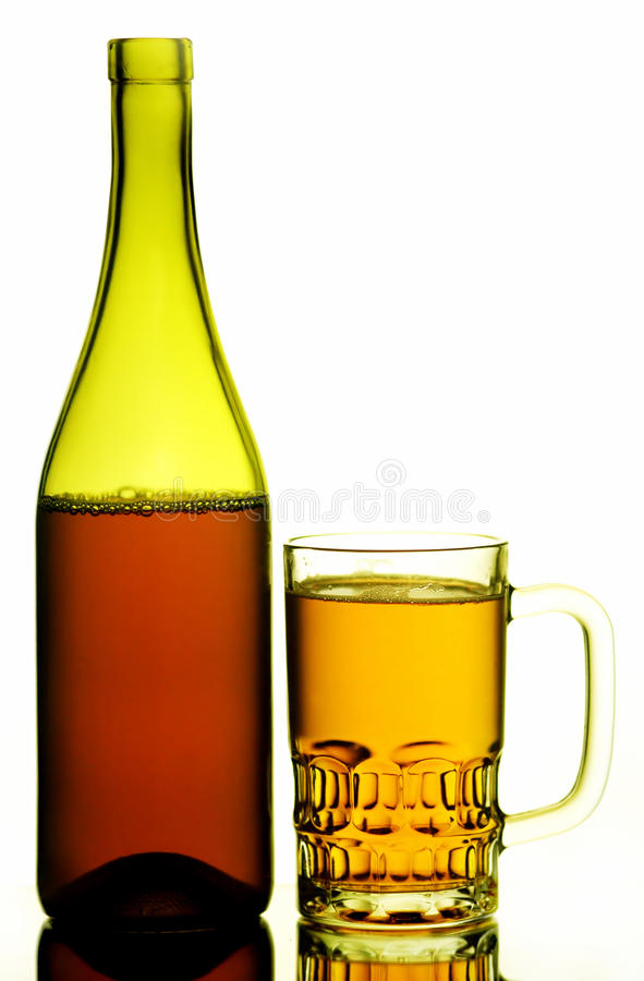 Beer mug and bottle. A bottle of beer and mug isolated on white background stock photos