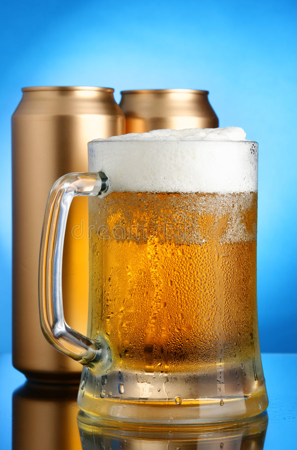 Beer mug and cans stock image