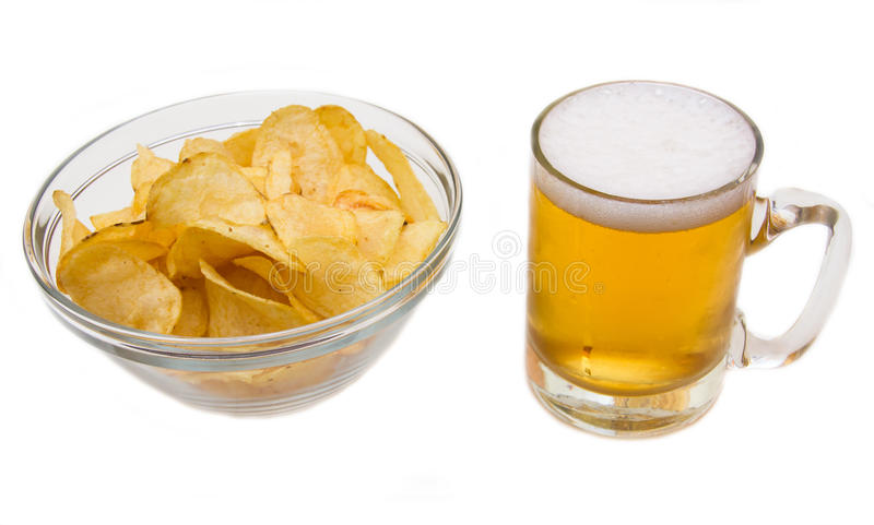 Beer mug with chips. Beer mug with fries on white background royalty free stock images