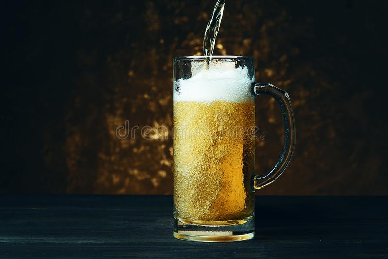 Beer mug on a dark background. royalty free stock images