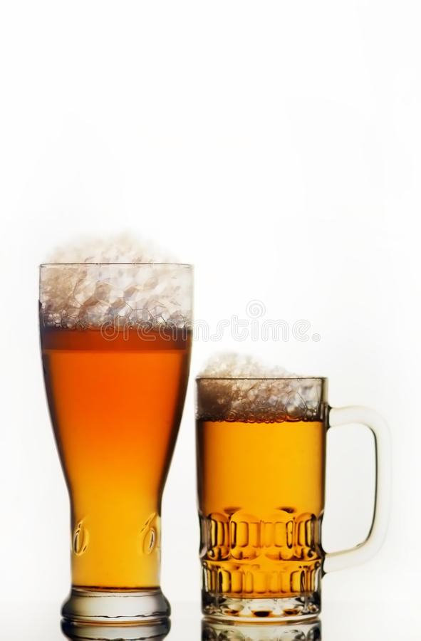 Beer mug and glass. Isolated on white royalty free stock photo