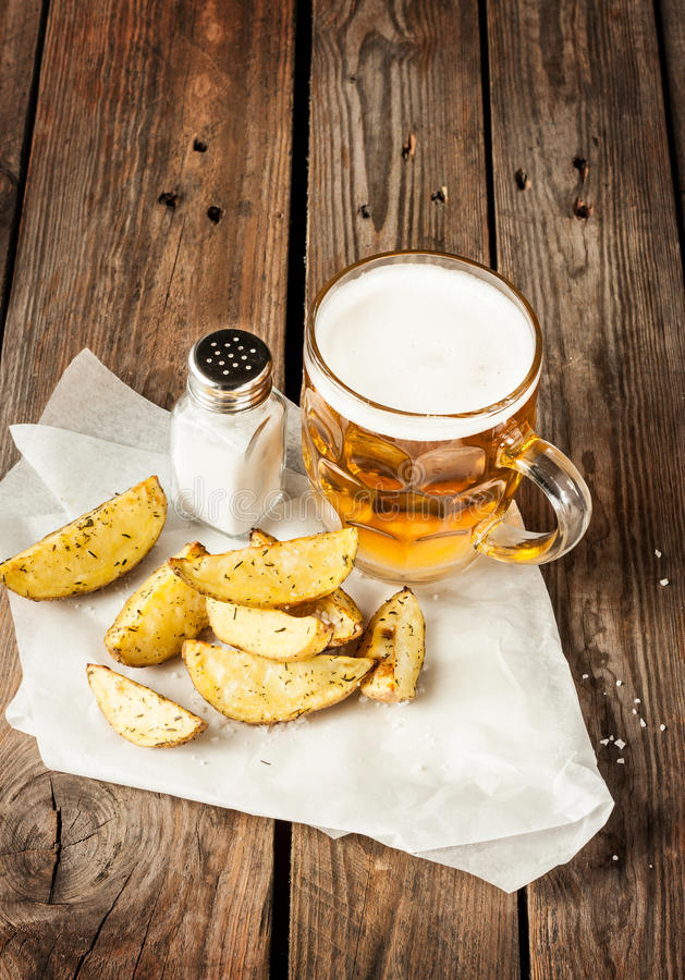 beer mug and potato wedges on rustic wood table stock photo image 38936917. Black Bedroom Furniture Sets. Home Design Ideas