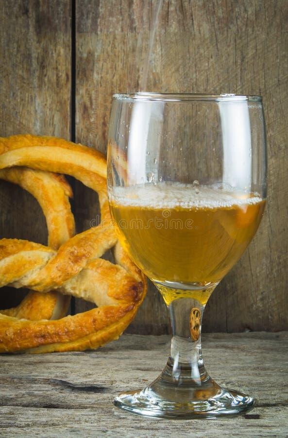 Beer mug and pretzel royalty free stock image