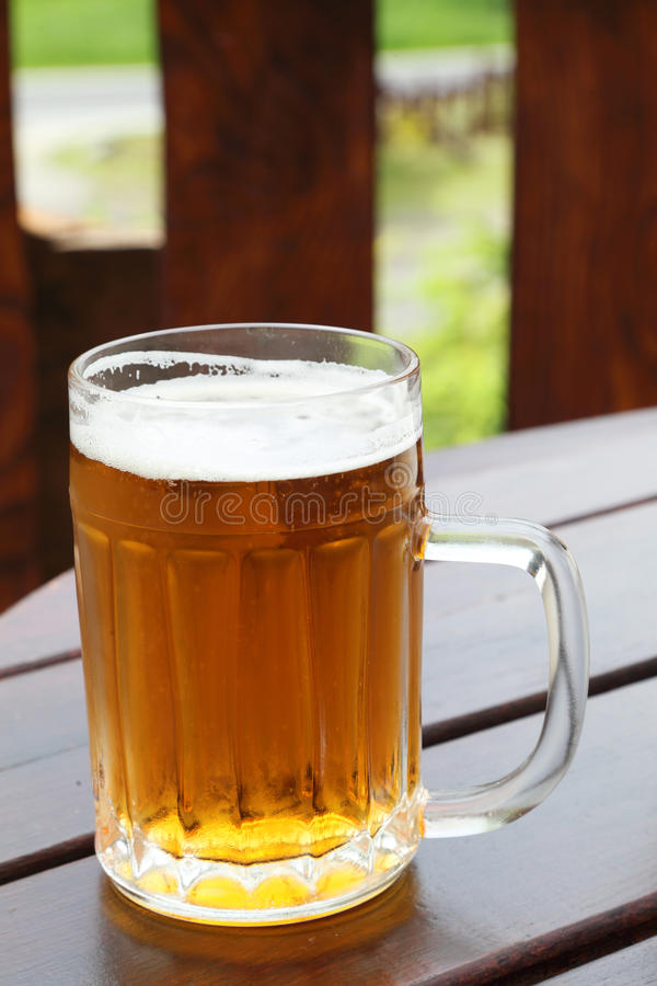 Beer mug on a table in a city restaurant outdoor royalty free stock images