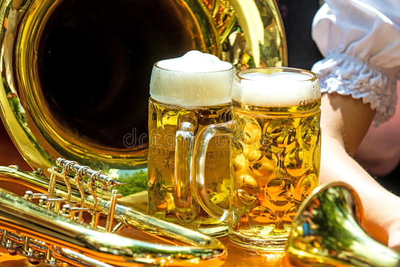 Beer mugs with trumpet royalty free stock photo