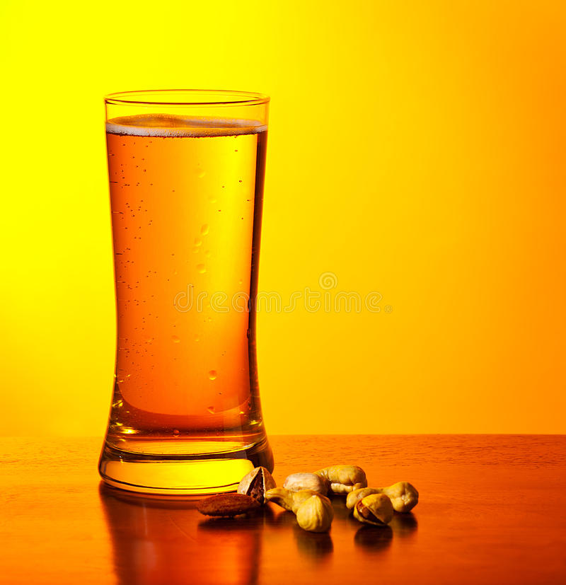 Beer and nuts royalty free stock photography