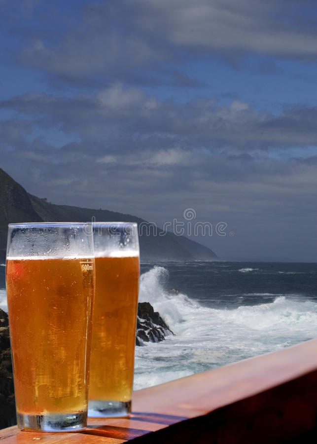 Beer at the ocean stock photos