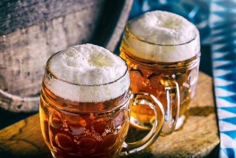 Beer. Oktoberfest.Two cold beers. Draft beer. Draft ale. Golden beer. Golden ale. Two gold beer with froth on top. Draft cold beer. In glass jars in pub hotel stock image