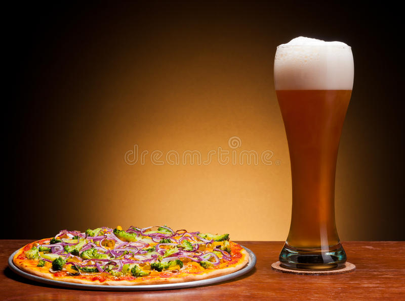Beer and pizza royalty free stock photography