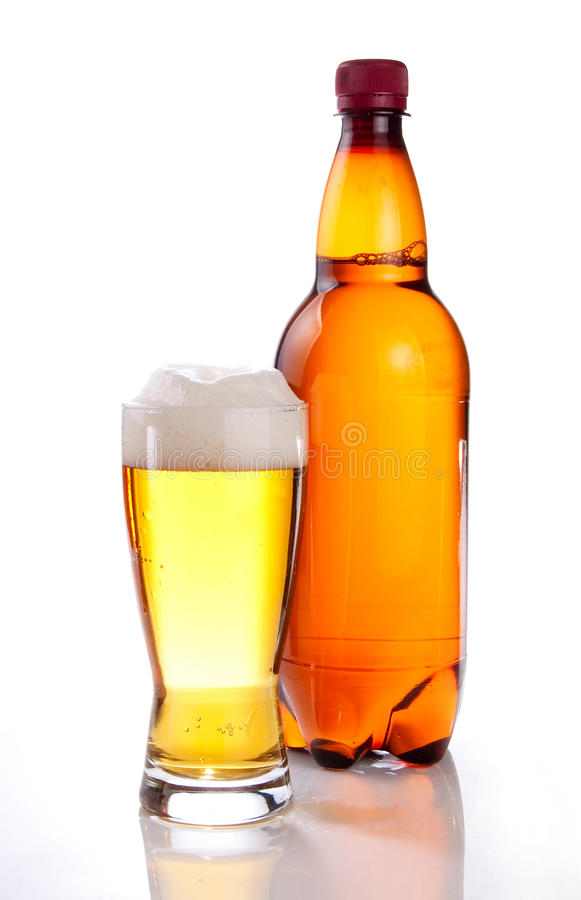 Beer in plastic bottle and glass on a white royalty free stock image