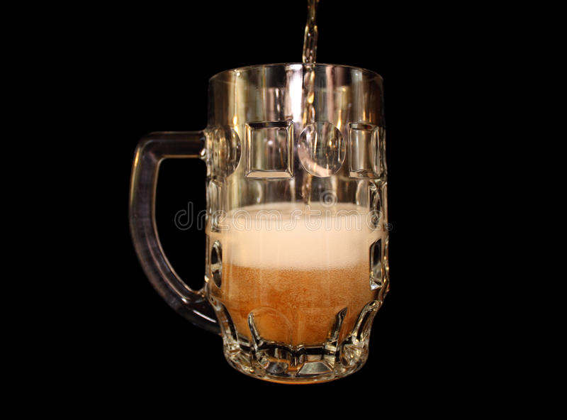 Beer Is Poured Into A Mug Stock Images