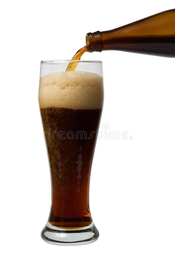 Beer pouring. A beer pouring into a glass on the white background royalty free stock photography