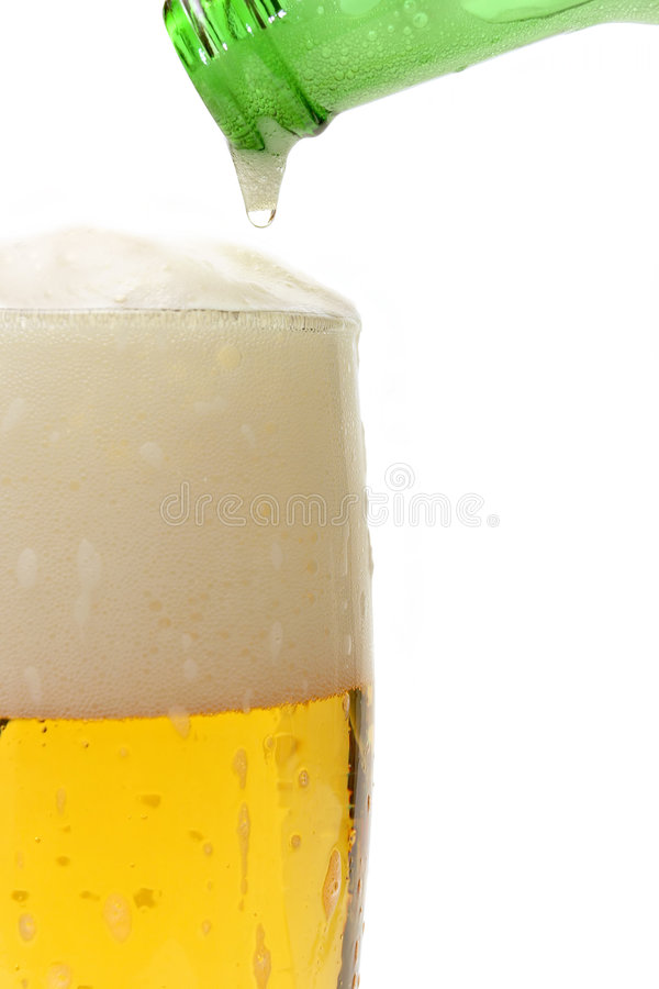 beer pouring in glass stock photo