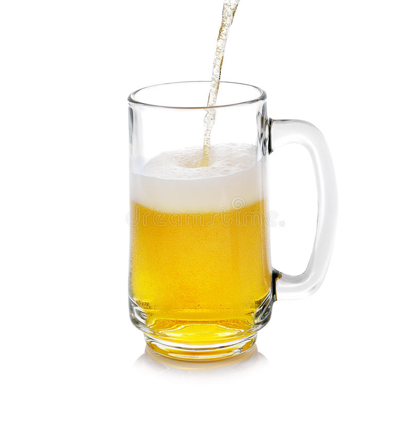 Beer pouring into glass stock images