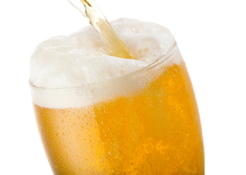 Beer pouring into glass royalty free stock photography