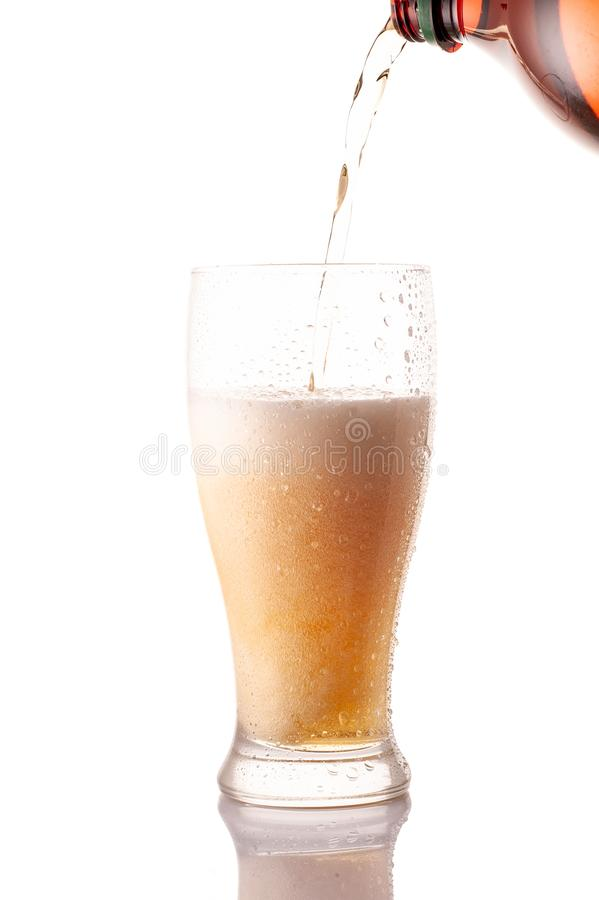 Beer is Pouring into glass. Beer pouring into glass on a white background royalty free stock image