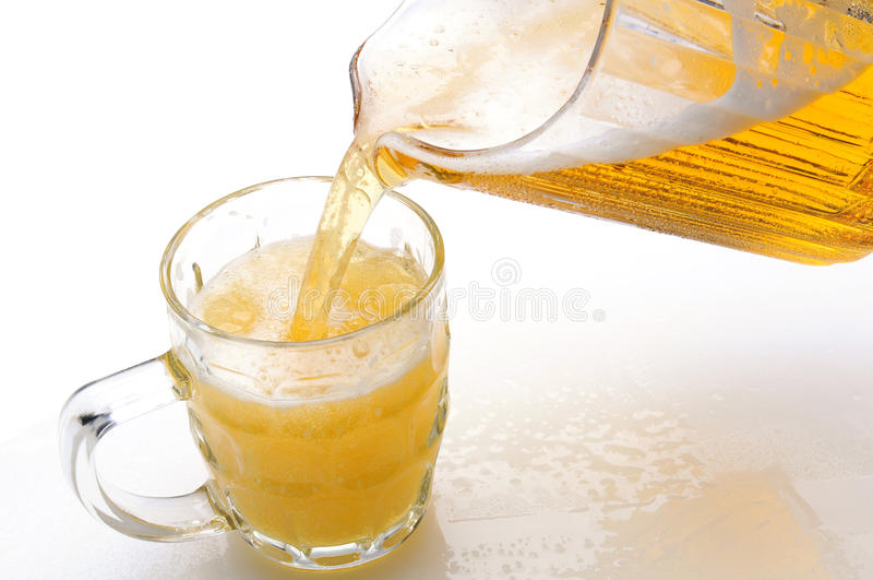 Download Beer Pouring Into Mug From Pitcher Stock Photo - Image of pitcher, cold: 23875020