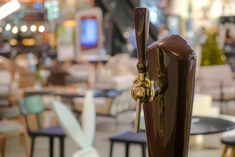 Beer pump in the cafe. stock photos