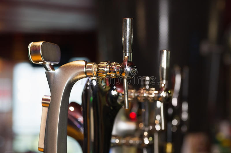Beer pumps in a row. In a bar royalty free stock photos