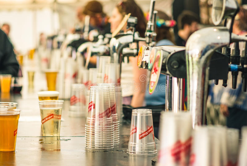 Beer pumps at Womad Festival. Charlton Park, UK - July 27 2017: Beer and cider pumps at the Womad Festival in Charlton Park royalty free stock photography