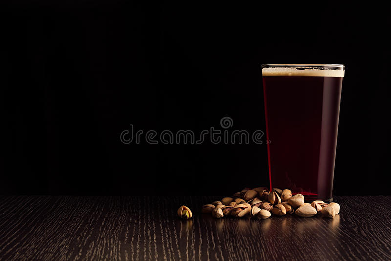 The beer red ale and snacks. stock photo