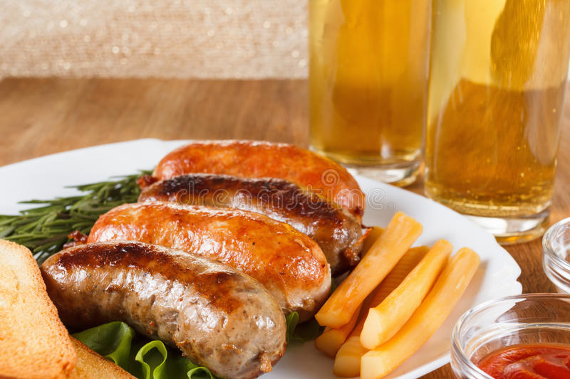 Beer and roast beef or chicken sausage stock image