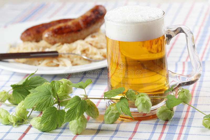 Beer and roasted sausages stock photography