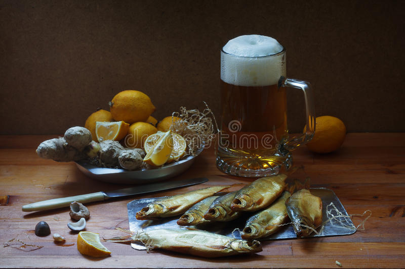Beer and salted fish royalty free stock photos