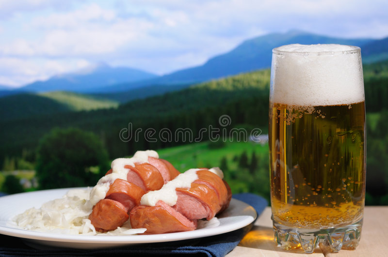 Beer and sausages stock photography