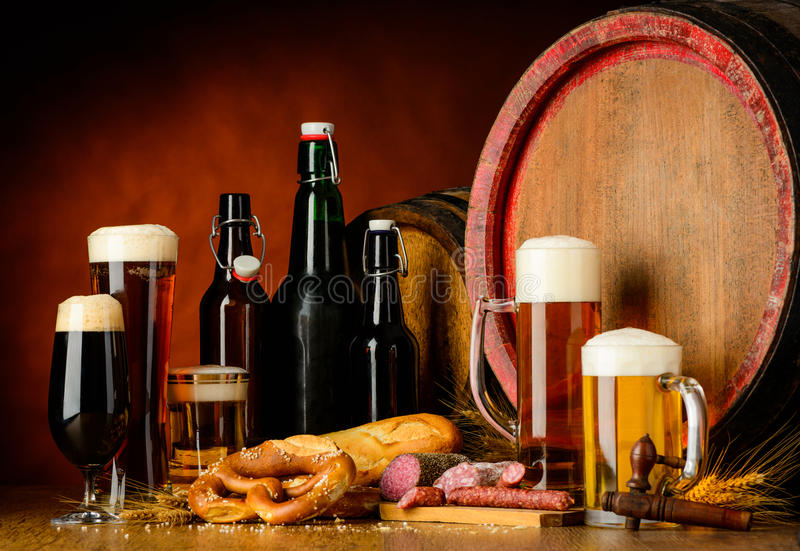 Beer and sausages on rustic table royalty free stock images