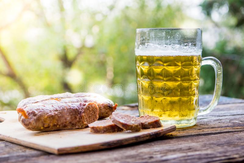 Beer and sausages on the table. Octoberfest theme.  stock photography