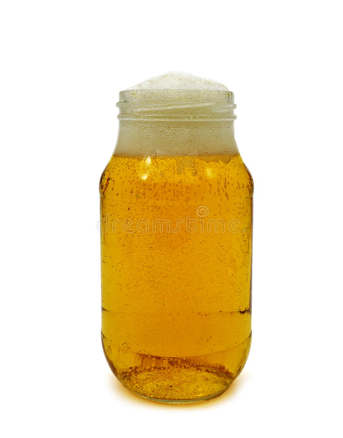 Beer served in a glass jar stock photography