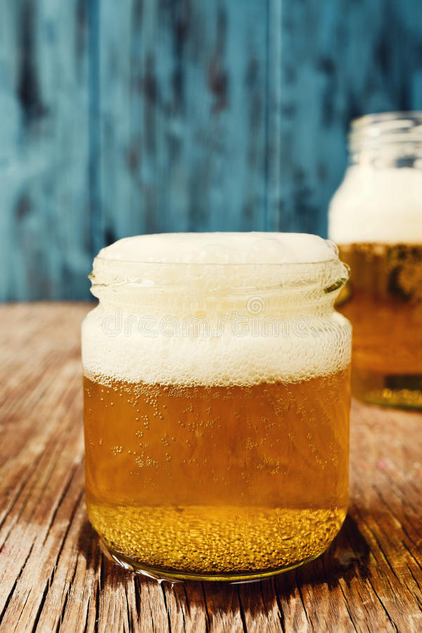 Beer served in glass jars royalty free stock image
