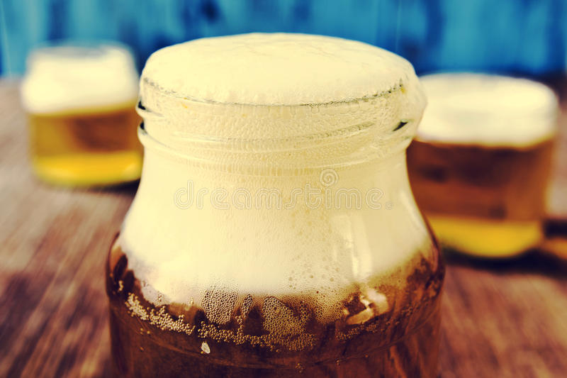Beer served in glass jars stock photo