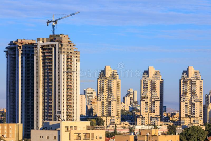 BEER-SHEBA, ISRAEL - JAN 19, 2019: High buildings. At background and one under construction stock photography