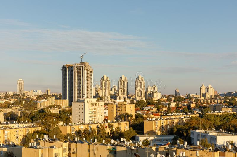 BEER-SHEBA, ISRAEL - JAN 19, 2019: Old district with two building. BEER-SHEBA, ISRAEL - JAN 19, 2019: Old district with the tall building under construction royalty free stock photos