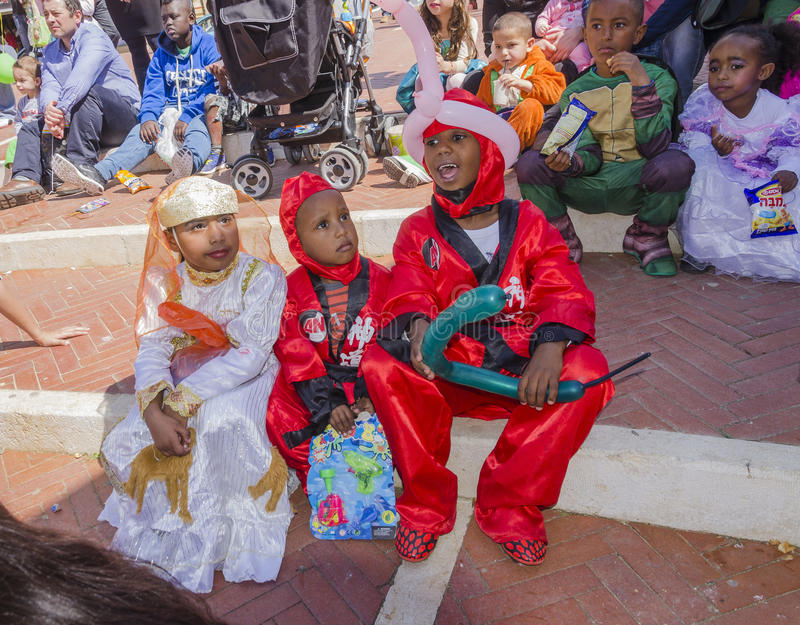 Beer-Sheva, ISRAEL - March 5, 2015:Children in scarlet and white carnival costumes. On the street- Purim in the city of Beer-Sheva on March 5, 2015 in Israel royalty free stock images