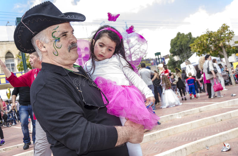Beer-Sheva, ISRAEL - March 5, 2015:An elderly man with a mustache, with a festive make-up in black and a black cowboy hat and hold royalty free stock photography