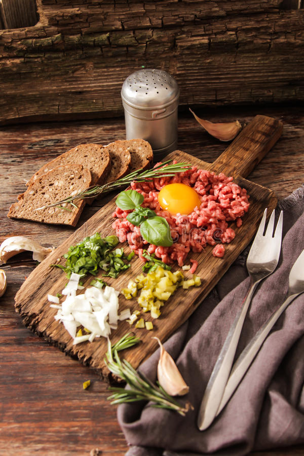 Beer snack Beef tartare with pickled cucumber and fresh onion. Beef tartare with pickled cucumber and fresh onion royalty free stock photo