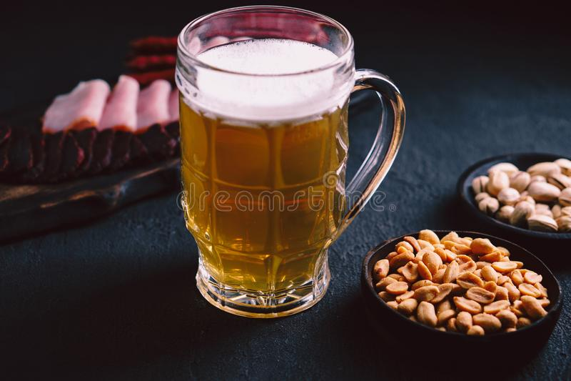 Beer and snacks. bar table. party, pub food. Beer and snacks. bar table. restaurant, pub, food concept. delicious craft unfiltered drink, salted nuts and meat royalty free stock photos