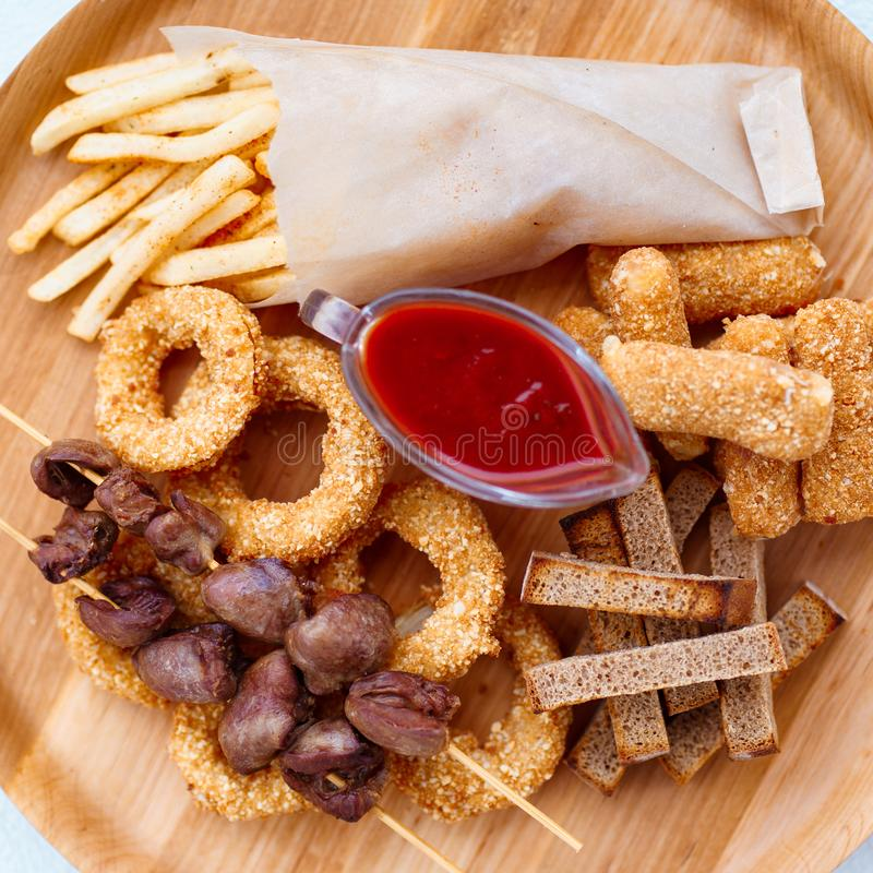Beer snacks set, bar table. pub, oktoberfest food. Beer snacks set, bar table. restaurant, pub, oktoberfest food. french fries, breaded fried cheese sticks stock photos