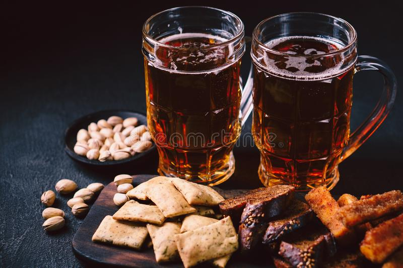 Beer and snacks set. pub, restaurant, bar food. Beer and snacks. bar table. restaurant, pub, food concept. craft lager drink, salted nuts and breaded fried stock image
