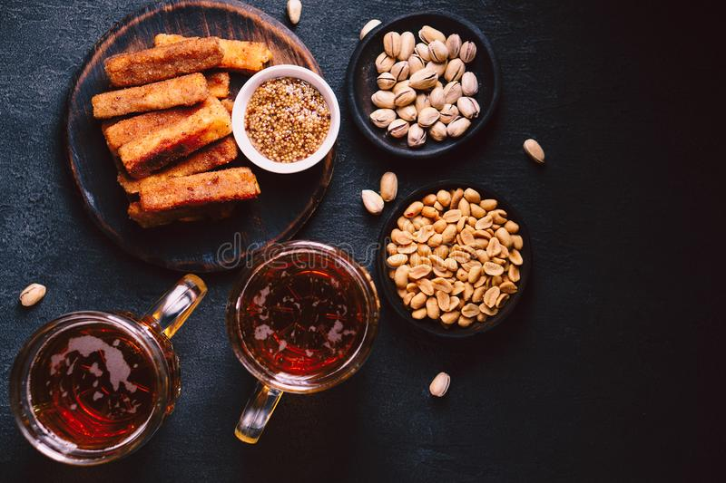 Beer and snacks set. pub, restaurant, bar food. Beer and snacks. bar table. restaurant, pub, food concept. craft lager drink, salted nuts and breaded fried stock photos