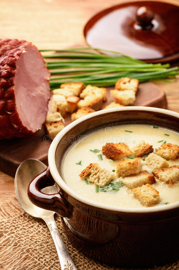 Beer soup with chicken fillet, ham and cheese. Beer soup with chicken fillet, ham and cheese royalty free stock photography