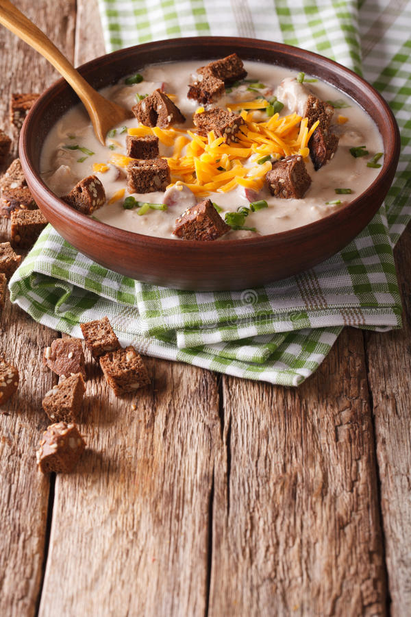 Beer soup with sausage, cheddar cheese and croutons in a bowl cl. Ose-up on the table. vertical royalty free stock photo